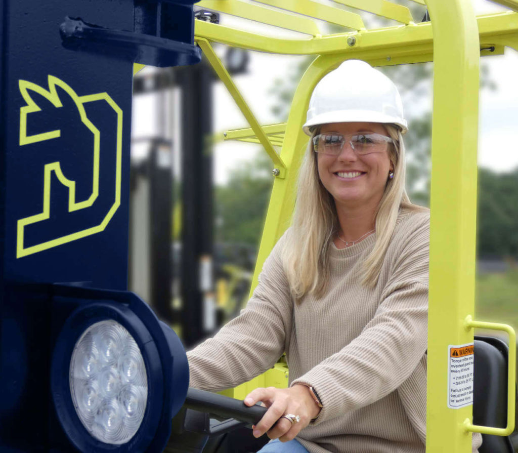 Woman driving Donkey certified pre-owned forklift